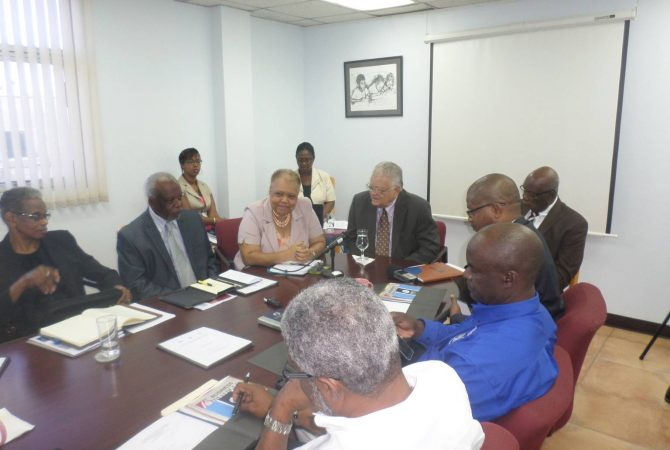 Minister of Industry, Commerce, Agriculture and Fisheries, Hon. Karl Samuda (head of table), addresses the newly appointed board members of the Jamaica Business Development Corporation (JBDC), Micro Investment Development Agency (MIDA), and the Self Start Fund, at the JBDC head office on Camp Road on May 19. At 3rd left is Chief Executive Officer of the JBDC, Valerie Veira.