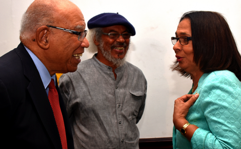 Minister of Labour and Social Security, Hon. Shahine Robinson (right), is in light conversation with Chairman of the Labour Market Reform Commission (LMRC), Dr. Marshall Hall (left), while LMRC Commissioner, Dr. Michael Witter, looks on. Occasion was the LMRC's End-of-Project Forum on Friday (July 7), at The Jamaica Pegasus hotel, New Kingston.