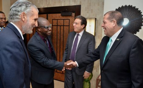 Minister of Finance and the Public Service, Hon. Audley Shaw (right), shakes hands with Office of Utilities Regulation (OUR) Director General, Ansord Hewitt, during Thursday's (October 5) session of the three-day Natural Gas Conference, jointly hosted by the Petroleum Corporation of Jamaica (PCJ) and the OUR, at The Jamaica Pegasus hotel in New Kingston. Looking on (from left) are PCJ Chairman, Russell Hadeed; and Chairman of the OUR, Joseph Matalon.