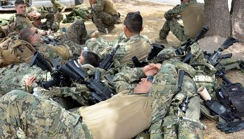 Soldiers relaxing after participating in a drill exercise at the Jamaica Defense Force (JDF) headquarters, Up Park Camp, on June 22. The men are among a contingent of over 1,000 military and police personnel from the Caribbean, United States (US), Canada, Britain, France, and Mexico, who are participating in a multinational security initiative dubbed Exercise Tradewinds.