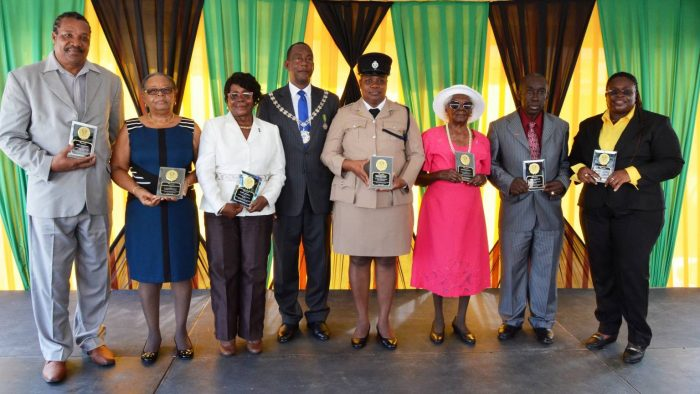 Mayor of Montego Bay, Councillor Glendon Harris (4th left) stands with the seven recipients of the 2016 Sam Sharpe Awardees, following the National Heroes Day Salute, Civic and Awards Ceremony, held in Sam Sharpe Square in Montego Bay on October 17. The awardees from left are: Educator, Irvin Atkinson; Mirriam Williams of the Western Mirror; Hotelier Doris Morgan; Deputy Superintendent of Police, Mercedes Curry; Centenarian and former Nurse, Iris Denniston; Educator Vivian Douglas; and Football Coach, Tracy Reid.