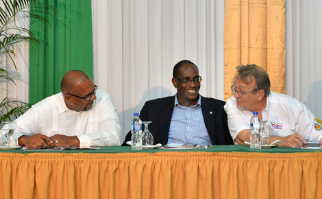 Chief Technical Director in the Ministry of Industry, Commerce, Agriculture and Fisheries, Stephen Wedderburn (centre), shares a light moment with Jamaica Pig Farmers Association (JPFA) President, Hanif Brown (left), and Vice President of Marketing and Agricultural Supplies of the Hi-Pro Division of the Jamaica Broilers Group, Conley Salmon. Occasion was the JPFA's 14th annual general meeting , held recently, at the Golf View Hotel in Mandeville.