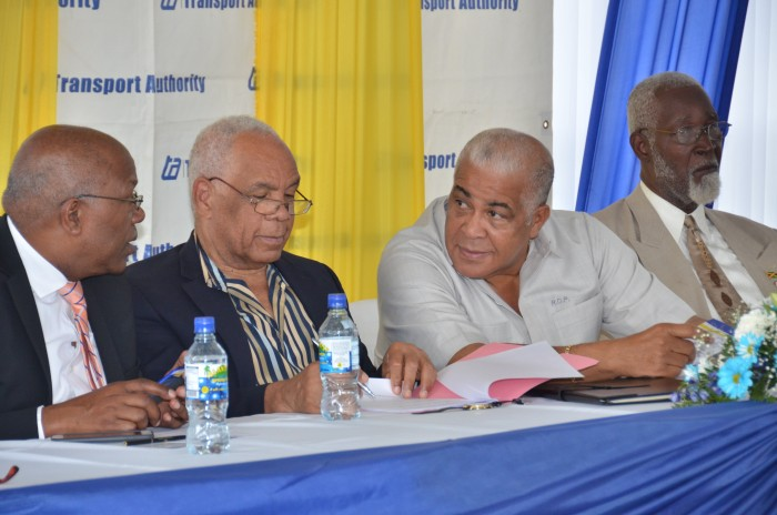 Transport, Works and Housing Minister, Dr. the Hon. Omar Davies (2nd left), peruses a document, while Minister without Portfolio, Ministry of Transport, Works and Housing, Hon. Dr. Morais Guy (left), engages Water, Land, Environment and Climate Change Minister, Hon. Robert Pickersgill (2nd right), during Wednesday's (February 3) official opening ceremony for the new Linstead Transportation Centre, in St. Catherine. Mr. Pickkersgill is the Member of Parliament for the area. At right is Custos Rotulorum for St. Catherine, Hon. Rev. Jeffrey McKenzie.