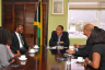 Minister of Health, Dr. the Hon. Christopher Tufton (centre) meeting with members of the Rotary Club of St. Andrew North, led by President, Glenroy Williams (3rd left), at his New Kingston offices, recently.