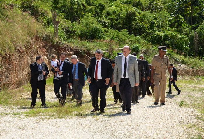 Governor of the Province of Bursa in the Republic of Turkey, Hon. Sahabettin Harput (right) and members of his delegation, tour a site in Ironshore Montego Bay on Friday, January 17, where his Government is looking to build a private high school for Jamaicans.