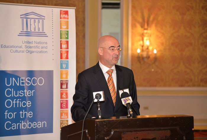 United Nations Resident Coordinator in Jamaica, Bruno Pouezat, addresses the Cluster Meeting for the Caribbean National Commissions for UNESCO, at the Hyatt Ziva Hotel in Rosehall, St. James on Monday, October 26 .