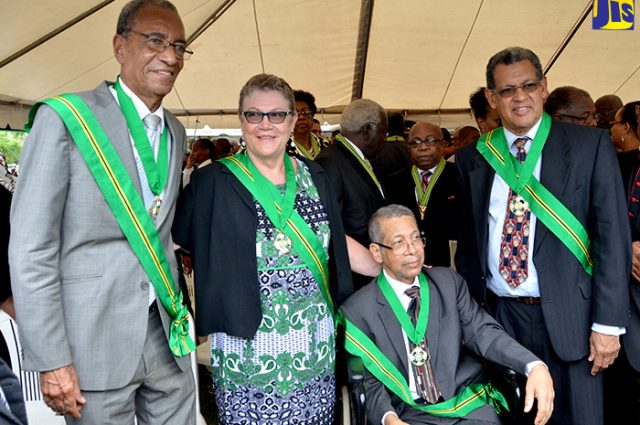 Recipients of the country's fifth highest honour, the Order of Jamaica, share in a light moment after being presented with the award, during the National Honours and Awards ceremony held on National Heroes Day today (October 17) on the lawns of King's House. From left are: Ambassador Anthony Johnson who received the award for distinguished national service in the public and private sectors and his contribution to the Jamaican foreign service; Professor Denise Eldemire-Shearer for outstanding and distinguished advocacy for senior citizens in the fields of health and welfare; former Member of Parliament Dr. Kenneth Lee O'Neil Baugh, for his distinguished service to Parliament, public service and for his contribution to medicine; and Professor Renn Osmond Holness for outstanding contribution to the field of medicine.