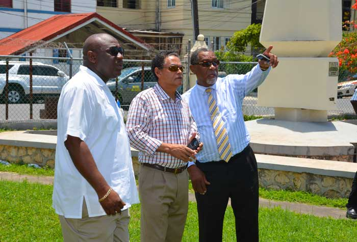 Mayor of Savanna-la-Mar, Councillor Bertel Moore (right), points to something of interest while in discussion with Minister of Local Government and Community Development, Hon. Noel Arscott (centre), during a tour of the site for the new Westmoreland Council office complex in Savanna-La-Mar, Westmoreland, on August 20.  At left is Deputy Mayor, Councillor Danree Delancy.