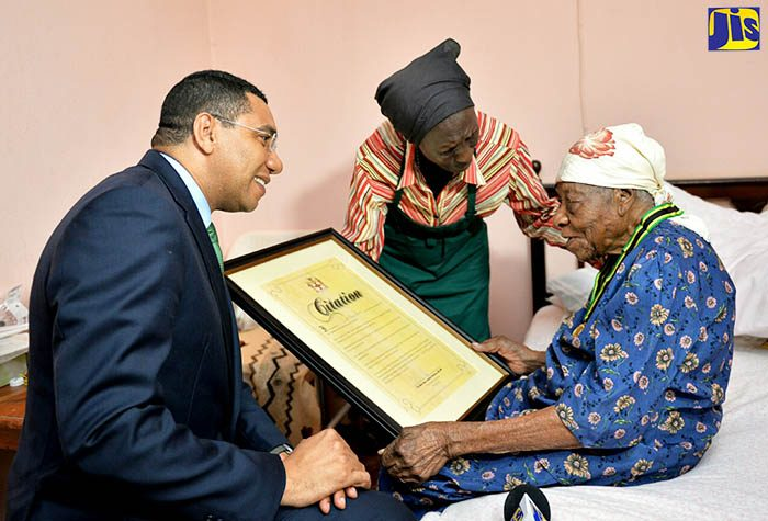 Andrew Holness - Violet Mosse Brown