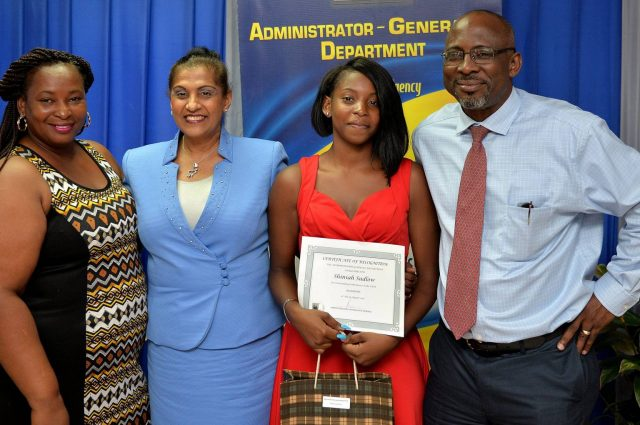 Administrator-General, Lona Brown (2nd left), shares a photo opportunity with Educational Award recipient, Shiniah Sudlow (2nd right), at the awards ceremony held at the Administrator-General's Department (AGD) in downtown Kingston on August 31. Others (from left) are Shiniah's mother, Winsome Holness; and Finance and Planning Executive at the AGD, Patrick Wright.