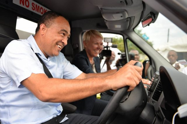Health Minister, Dr. the Hon. Christopher Tufton, tries out one of the six ambulances provided to the health sector by the European Union (EU), during a ceremony at the May Pen Hospital in Denbigh, Clarendon on April 20. Sharing the moment is Head of Delegation, EU to Jamaica, Ambassador Malgorzata Wasilewska.