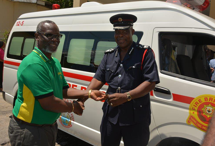 Local Government and Community Development Minister, Hon. Desmond McKenzie (left), presents the keys to a new ambulance to Jamaica Fire Brigade Commissioner, Raymond Spencer. The presentation was made at the Lucea Fire Station in Hanover on Friday, September 22.