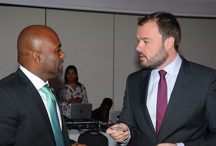 Science, Energy and Technology Minister, Hon. Dr. Andrew Wheatley (left), converses with Microsoft's Director of Corporate, External and Legal Affairs for Latin America, Marlon Fetzner, during a digital innovation conference, organized by the technology firm's local office, at the Spanish Court Hotel in New Kingston on Thursday, February 9.