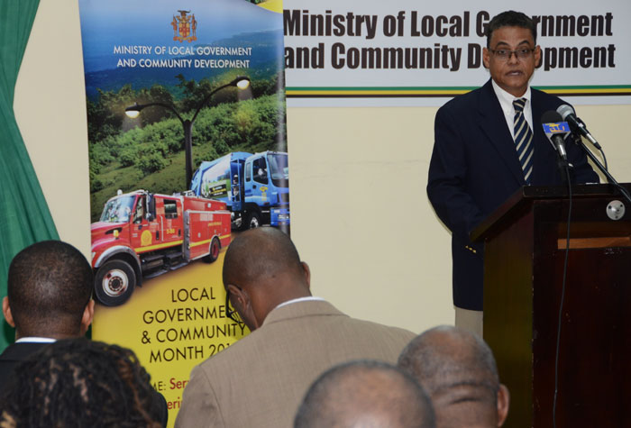 Minister of Local Government and Community Development, Hon. Noel Arscott, addresses the press launch of Local Government and Community Month 2014, at the Ministry's Hagley Park Road headquarters, in Kingston, on  October 23.