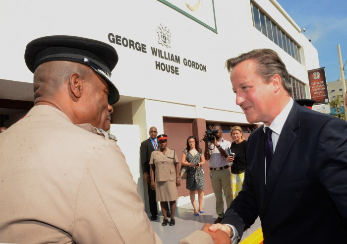 The United Kingdom's Prime Minister, Rt. Hon. David Cameron (right), is greeted by Commissioner of Police, Dr. Carl Williams, on his arrival at Gordon House where he addressed a joint sitting of Parliament, today (September 30).