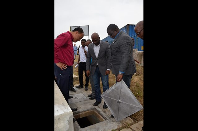 (From left) Minister of Health, Dr. the Hon. Christopher Tufton; Minister of Science, Energy and Technology, Dr. the Hon. Andrew Wheatley; and Executive Director of the Scientific Research Council (SRC), Dr. Cliff Riley, view a section of the bio digester wastewater treatment system at the Noel Holmes Hospital in Lucea, Hanover. The system, built by the SRC, was officially handed over on Thursday (October 26).