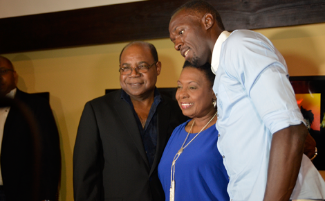 Minister of Tourism, Hon. Edmund Bartlett (left) and Minister of Culture, Gender, Entertainment and Sport, Hon. Olivia Grange with World and Olympic sprint champion Usain Bolt at the official opening of the new Usain Bolt Tracks and Records Sports Bar and Restaurant in Pineapple Place Plaza, Ocho Rios, St. Ann, on September 14.