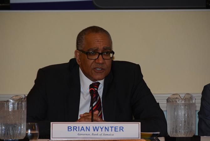 Bank of Jamaica Governor, Brian Wynter, addressing journalists during a quarterly media briefing held at the Hilton Rose Hall Hotel on May 19, in Montego Bay.