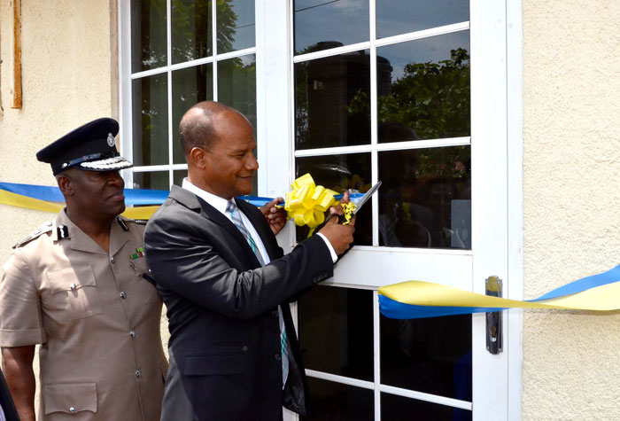 National Security Minister, Hon. Peter Bunting (right), cuts the ribbon to formally open the Hellshire Police Station in St. Catherine on Thursday, April 17. Looking on is Police Commissioner, Owen Ellington.