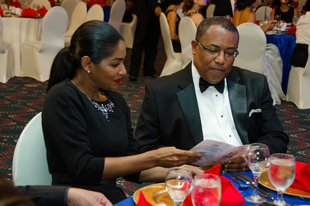 Minister of Industry, Investment and Commerce, Hon. Anthony Hylton (right), and Minister of Youth and Culture, Hon. Lisa Hanna, share a programme at Burger King's 30th anniversary awards ceremony, held at the Pegasus Hotel on Monday, October 27.