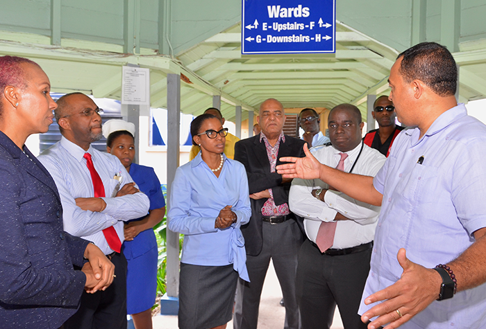 Health Minister, Dr. the Hon. Christopher Tufton (right), emphasizes a point to Senior Medical Officer at the National Chest Hospital in St. Andrew, Dr. Terry Baker (4th left), during a tour of the institution on Friday, January 13. Others, from left, are: Finance and Public Service State Minister and Member of Parliament for Eastern St. Andrew, where the hospital is located, Hon. Fayval Williams; Chief Executive Officer, Vincent Riley; and Director of Nursing Services, Nicole Brown; Consultant Cardiothoracic Surgeon, Dr. Joseph Blidgen (2nd right); and other officials at the institution.