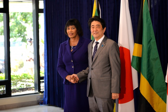 Prime Minister, the Most Hon Portia Simpson Miller shakes the hand of Prime Minister of Japan, His Excellency, Mr. Shinzo Abe at the Office of the Prime Minister, in St. Andrew, on September 30, where they held bilateral talks.