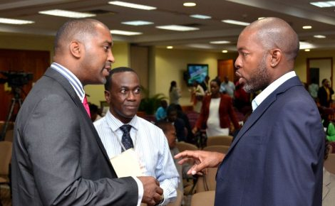 Minister of State in the Ministry of Science, Technology, Energy and Mining, Hon. Julian Robinson (left), in discussion with Chief Technical Officer, Caribbean Cyber Security Centre, Deon Olton (right), at the National Conference on Cyber Security and Digital Forensics at the University of the West Indies (UWI) Regional Headquarters, in St. Andrew, today, October 1. At centre is Director, Mona ICT Policy Centre, Mona School of Business and Management, Professor Hopeton Dunn.