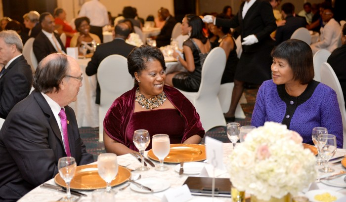 Prime Minister, the Most Hon. Portia Simpson Miller (right), having a light exchange with Director of the Caribbean-Canada Emerging Leaders' Dialogue (CCELD) 2015, Mr. Robert Taylor (left) and Chair of the CCELD Local Steering Committee, Mrs. Lisa Bell (centre), during the CCELD dinner, held at the Pegasus Hotel on Thursday (October 1). The CCELD is a capacity building programme geared at Government, business and civil society leaders of the Caribbean and Canada. The closing ceremony will be hosted in Jamaica, today (October 2).