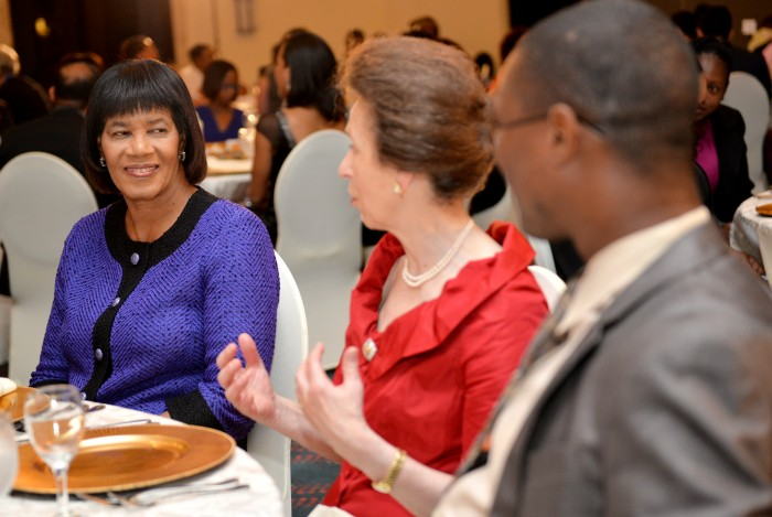 Prime Minister, the Most Hon. Portia Simpson Miller (left), shares a light moment with Her Royal Highness, the Princess Royal, and Minister of State in the Ministry of Foreign Affairs and Foreign Trade, Hon. Arnaldo Brown, during the Caribbean-Canada Emerging Leaders' Dialogue (CCELD) dinner, held on Thursday (October 1), at the Pegasus Hotel. The CCELD is a programme to build the capacity of Caribbean and Canadian leaders from the business sector, Government and civil society. The Princess Royal is the President of the CCELD.