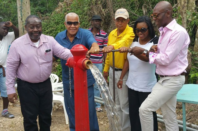 Minister of Water, Land, Environment And Climate Change Hon. Robert Pickersgill (2nd  left), turns on the Cassava Pond water supply system in North West St. Catherine, during a commissioning ceremony on Thursday (October 22).  Others (from left) are: Managing Director of the Rural Water Supply Limited (RWSL), Audley Thompson;  Mayor of Spanish Town, Norman Scott; Commissioner at the RWSL, Debbie-Ann Kerr-Scott; and Councillor for the Lluidas Vale Division, Hugh Graham.