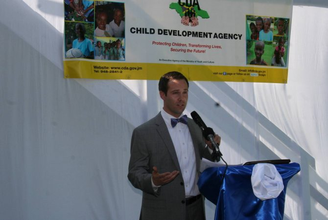 "Chairman of the Board of the Washington based non-profit organization, Embracing Orphans, Carl Robanske, which has donated a house in Reading, Montego Bay, to the Child Development Agency (CDA) for use as a transition home for female wards of the state preparing to exit state care, as he address the official opening ceremony for the facility named ""My Father's House""."