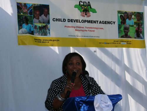 Acting Chief Executive Officer of the Child Development Agency, Mrs. Rosalee Gage-Grey addresses the official opening of a transition house for female wards of the state, My Father's House, located in Reading, St. James.