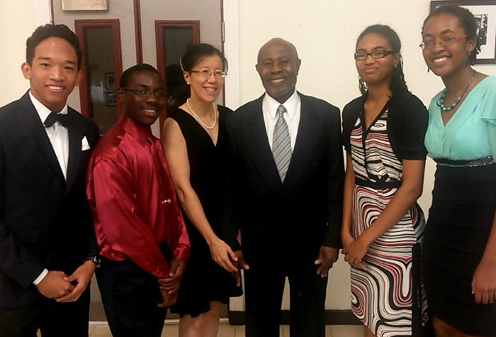 The four Jamaican students, who participated in the Student Programme for Innovation in Science and Engineering (SPISE), share a moment with Massachusetts Institute of Technology (MIT) Professor and Director of SPISE, Professor Cardinal Warde (3rd right) and his wife, Dr. Dinah Sah (3rd left). The students (from left) are: upper sixth former at the American International School of Kingston (AISK), Brandon Chin Loy; York Castle High student, Fitzroy Wickham; St. Andrew High student, Melissa Douglas; and DeCarteret High student, Erica Virgo. The Jamaicans were part of a group of 18 Caribbean students exposed to science and engineering courses through the programme, put on by the Caribbean Science Foundation, between July 18 and August 14, at the University of West Indies, Cave Hill campus.