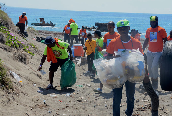 Volunteers remove plastic bags, bottles, old tyres and other garbage from the Shipwreck beach along the Palisadoes Strip in Kingston on Saturday, September 20, in observation of International Coastal Clean-Up Day.