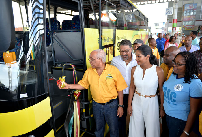 Minister of Transport, Works and Housing, Dr. the Hon. Omar Davies (left), cuts the ribbon to launch the Jamaica Urban Transit Company (JUTC) Kingston City Tours, at the Half-Way-Tree Transport Centre, on Saturday, August 1. Looking on  (from second left) are:  Minister of Tourism and Entertainment, Hon. Dr. Wykeham McNeill; Minister of Youth and Culture, Hon. Lisa Hanna;  Managing Director of the JUTC, Mr. Colin Campbell and Mayor of Kingston, Senator Councillor, Dr. Angela Brown-Burke.