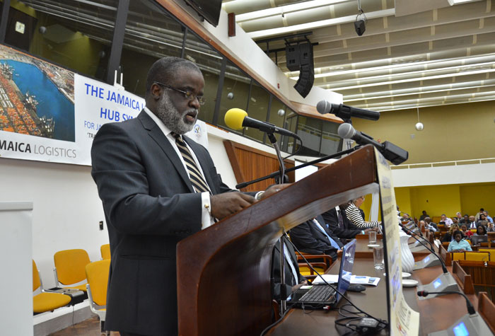 Chairman of the Logistics Hub Task Force, Dr. Eric Deans, addresses members of the local business community and other stakeholders at the opening session of the two-day Jamaica Chamber of Commerce/JAMPRO Jamaica logistics hub symposium, at the Jamaica Conference Centre, downtown Kingston, on January 21.