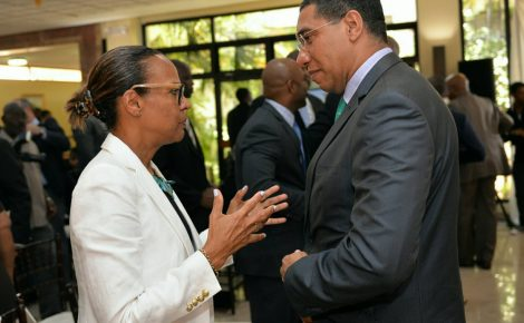 Prime Minister, the Most Hon. Andrew Holness (right), listens to a point from General Manager, Inter-American Development Bank (IDB) Caribbean, Therese Turner-Jones, during an e-Governance briefing at the Office of the Prime Minister in St. Andrew on Friday (June 9).