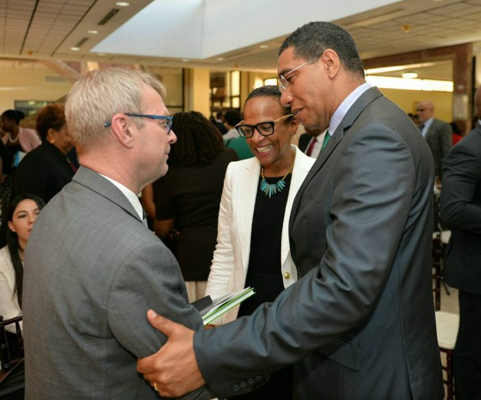 Prime Minister, the Most Hon. Andrew Holness (right), shares a warm handshake with Executive Director, e-Governance Academy, Estonia, Dr. Arvo Ott (left), following an e-Governance briefing at the Office of the Prime Minister in St. Andrew on Friday (June 9). Also pictured is General Manager, Inter-American Development Bank (IDB) Caribbean, Therese Turner-Jones.