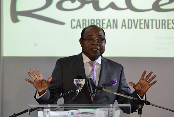 Minister of Tourism, Hon. Edmund Bartlett, addresses the Island Routes Caribbean Adventures Certified Partner Conference 2016, at the Sandals Ochi Beach Resort in St. Ann on September 14.