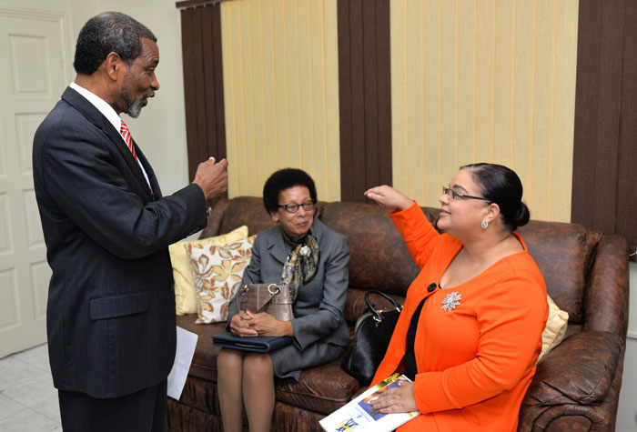 Minister of Information, Senator the Hon. Sandrea Falconer (right), having a light discussion with President of the Northern Caribbean University (NCU), Dr. Trevor Gardner (left), prior to the start of the institution's Honours Convocation ceremony on October 23, at its location in Mandeville, Manchester. Looking on at centre is the university's Vice President for Academic Administration, Dr. Marilyn Anderson.
