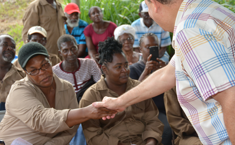 Minister of Finance and the Public Service, Hon. Audley Shaw, greets farmers on arrival at the Schwallenburgh Greenhouse Cluster and Water Harvesting Project in Rio Hoe, St. Ann, on September 15.