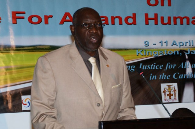 Minister of Health, Hon. Dr. Fenton Ferguson addresses day-two of the PAN-Caribbean Partnership against HIV/AIDS' (PANCAP) consultation on justice and human rights being held at the Jamaica Pegasus hotel in New Kingston from April 9 to 11. The forum is being held under the theme: 'Advancing Justice for All and Human Rights in the Caribbean'.