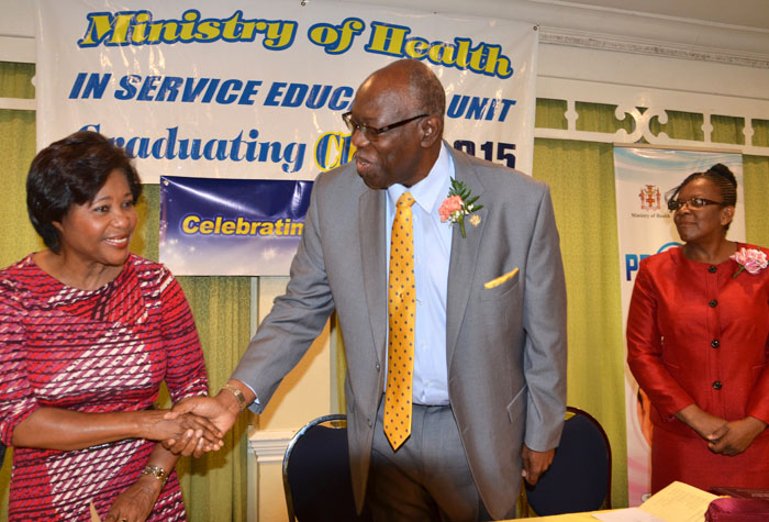 Health Minister, Hon. Dr. Fenton Ferguson (centre), greets Her Excellency, the Most Hon. Lady Allen, at the graduation ceremony for nurses and midwives on July 2, at the Knutsford Court Hotel in Kingston. Looking on is Chief Nursing Officer in the Ministry of Health, Marva Lawson-Byfield.