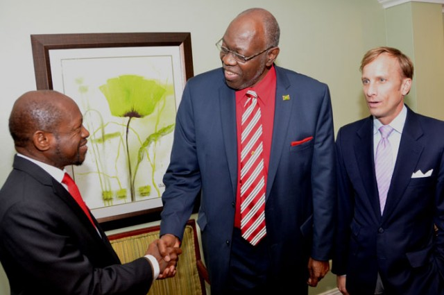 Minister of Health, Hon. Dr. Fenton Ferguson (centre) greets Prime Minister of St. Kitts and Nevis, Dr. Denzil Douglas (left) prior to the start of a Global Fund press briefing at the Jamaica Pegasus Hotel in Kingston on April 9. Also sharing in the moment is Executive Director, Global Fund, Mark Dybul. The Global Fund provides support for HIV/AIDS, tuberculosis, and malaria projects around the world. It is an international financing institution that supports countries in their fight against three of the world's most devastating diseases.