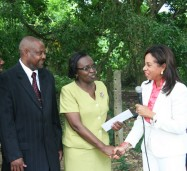 Minister of State in the  Ministry of Industry, Investment and Commerce, Hon. Sharon Ffolkes-Abrahams (right),  hands over a letter of commitment for $50,000 to Acting Principal of the Howard Cooke Primary School, in Montego Bay, Mrs. Mavis Moses (2nd right),  to go towards the construction of a perimeter fence for the school.  Sharing in the moment are Principal of the institution, Mr. Dave Scott (2nd left), and Chairman of the Board of Governors for the school, Philemon Samuels (left). Occasion was a ground breaking ceremony  for the fence at the school on November 7.