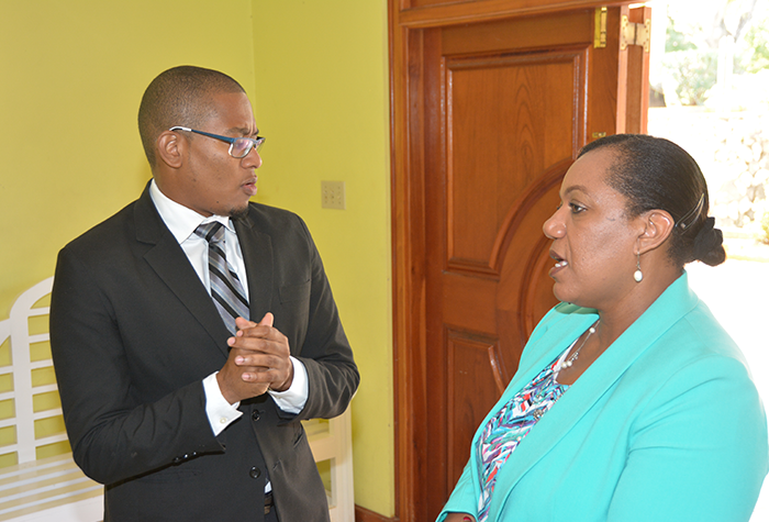 Minister of State in the Ministry of Education, Youth and Information, Hon. Floyd Green (left) shares in discussions with Chief Executive Officer of the Child Development Agency, Rosalee Gage-Grey, during a special meeting for foster parents from St. James, Westmoreland, Trelawny and Hanover, held at the West Jamaica SDA Conference Centre in Mt. Salem Montego Bay, yesterday (September 15).