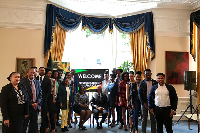 High Commissioner to the United Kingdom (UK), His Excellency Seth Ramocan (seated 10th right); Deputy High Commissioner, Angella Rose Howell (seated 11th left); and Counsellor, Political and Economic Affairs, Carol Lee-Lea (left), share a photo opportunity with Jamaican scholars in the UK at a special luncheon at the High Commission in London on July 6.