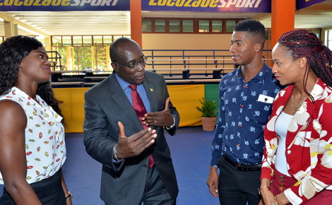 Minister of Education, Youth and Information, Senator the Hon. Ruel Reid (second left), raps with G.C. Foster College/Sprintec Track Club athletes during a reception held in their honour at the campus of the G.C. Foster College in St. Catherine on Thursday (September 21). The athletes (from left) are Anneisha McLaughlin-Whilby; Demish Gayle; and Anastasia Le-Roy. They were among 10 athletes who were presented with plaques in recognition of their performance during the International Association of Athletics Federations (IAAF) World Championships in London this year.