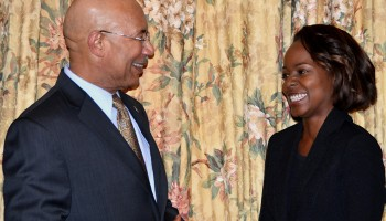 Governor-General, His Excellency the Most Hon. Sir Patrick Allen (left), shares a light moment with Jamaica's 2016 Rhodes Scholar, Sherona Forrester, following the announcement ceremony at King's House on November 19. The 24-year old, who will he  heading to Oxford University in London next year, is a member of Jamaica's Senior Football Team.