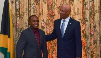 Governor General, Sir Patrick Allen congratulates the 2015 Jamaica Rhodes Scholar, 23-year-old Tariq Parker. The announcement was made on Thursday, November 20 at King's House in St Andrew.